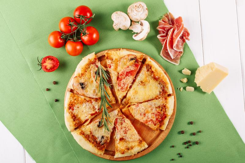 Stale Dry Pepperoni Pizza with Ham Top Flat Lay stock photo