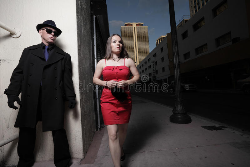 Stalker. Man stalking the woman in the city stock photography