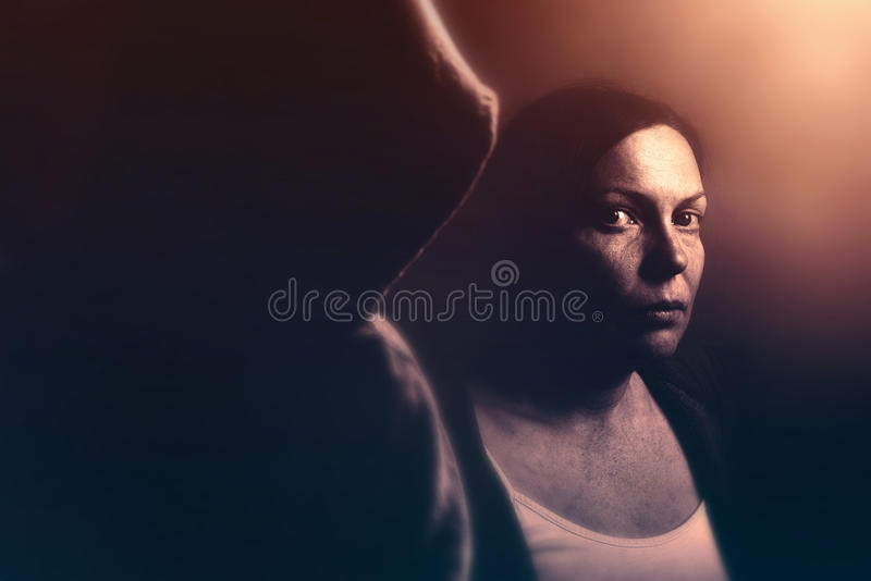 Stalker concept, retro toned. Stalker concept, intense low key portrait of women being stalked, retro toned image with selective focus stock photos