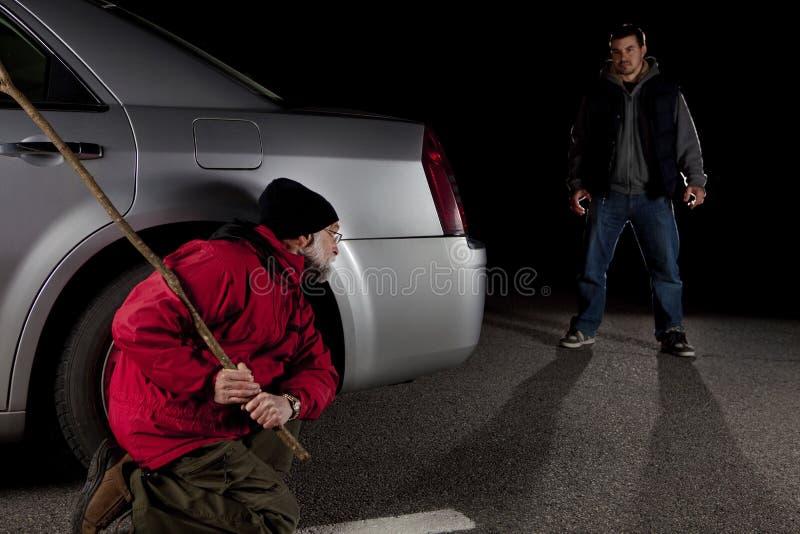 Stalker en slachtoffer stock foto