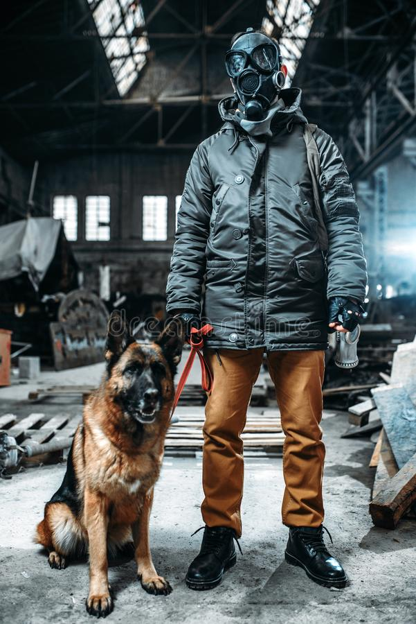 Stalker in gas mask and dog in radioactive zone. Stalker soldier in gas mask and dog in radioactive zone, friends in post apocalyptic world. Post-apocalypse royalty free stock photography