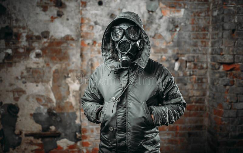 Stalker in gas mask survivor man after nuclear war stock image