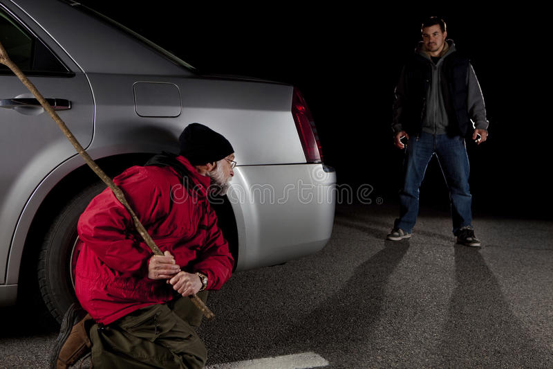 Stalker and victim. Self defense concept stock photo