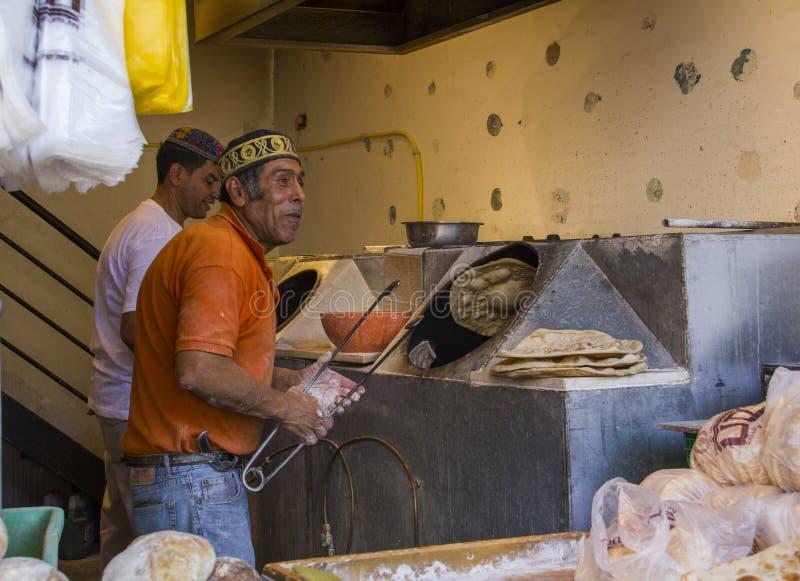 Bukhara Jews Traditional Bakery - making and selling fresh bread in busy Jerusalem market Mahane Yehuda.Jerusalem, Israel. Jerusalem,Israel - July 31,2015 royalty free stock photo