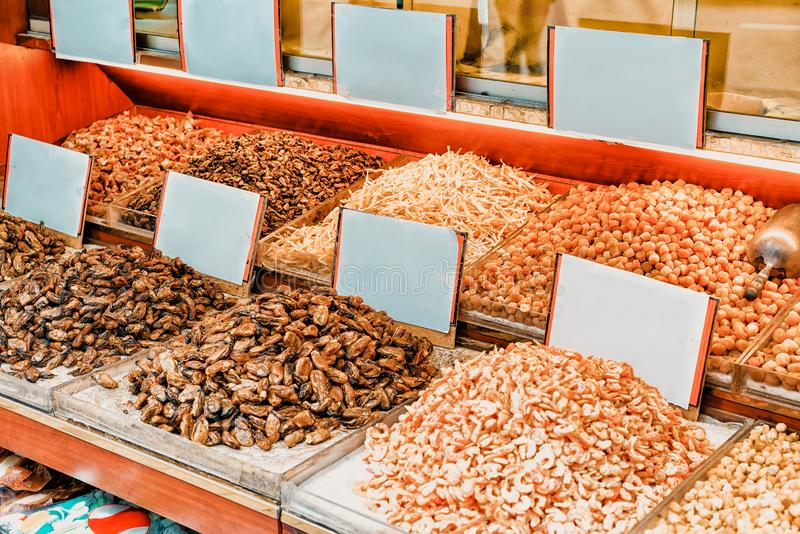 Stall with seafood streets of the center of Kowloon in Hong Kong. Selective focus stock photo