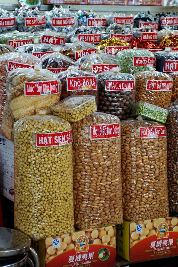 Stall in a city market in Vietname. Stall selling nuts and candy in the main market in Ho Chi Minh City, Vietnam stock photo