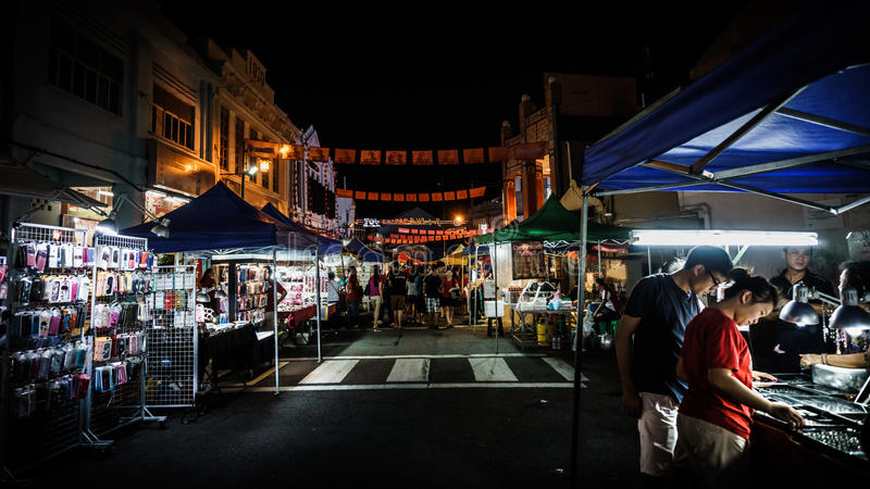 Stalls Around Malacca Jonker Walk Street. Malacca, Malaysia - April 10, 2015: The stall of many shops around Jonker Walk street , China town in Malacca stock image