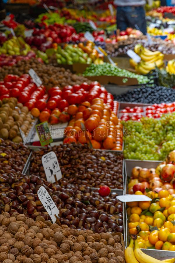 Stalls of fruit and vegetables in greengrocer market stall. Fruit and vegetables laid out in a Greek market stall. Shallow focus royalty free stock images