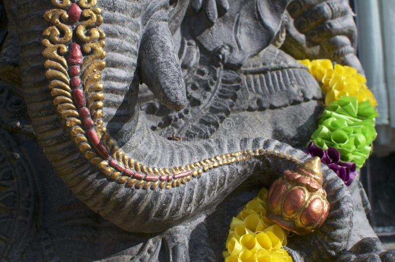 Stamdetalj av en svart Ganesha staty arkivfoton