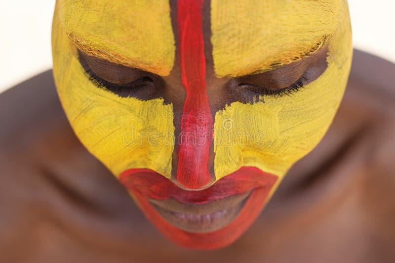 Stammes- Gesicht stockbild
