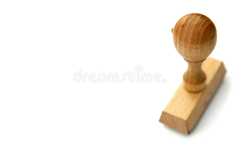 Stamp. Wooden stamp on clear white backgound, distance blur royalty free stock image
