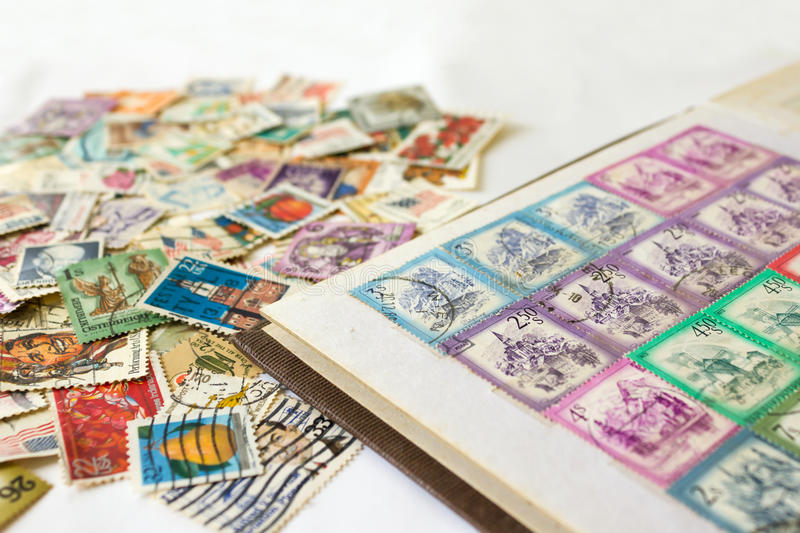 Stamp album with postage stamps royalty free stock photo