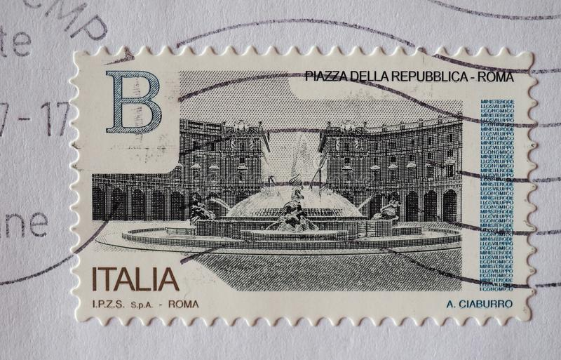 Stamp of Italy in Turin. TURIN, ITALY - CIRCA DECEMBER 2017: a class B stamp printed by Italy showing Piazza della Repubblica square in Rome royalty free stock image