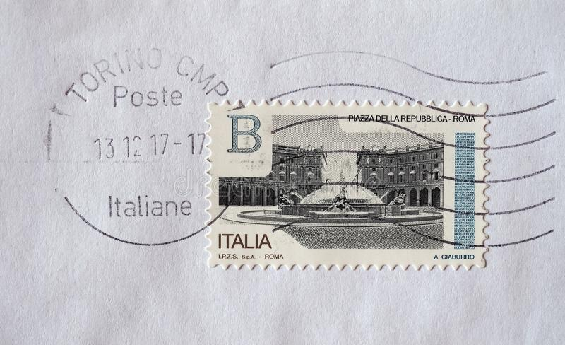 Stamp of Italy in Turin. TURIN, ITALY - CIRCA DECEMBER 2017: a class B stamp printed by Italy showing Piazza della Repubblica square in Rome royalty free stock photos