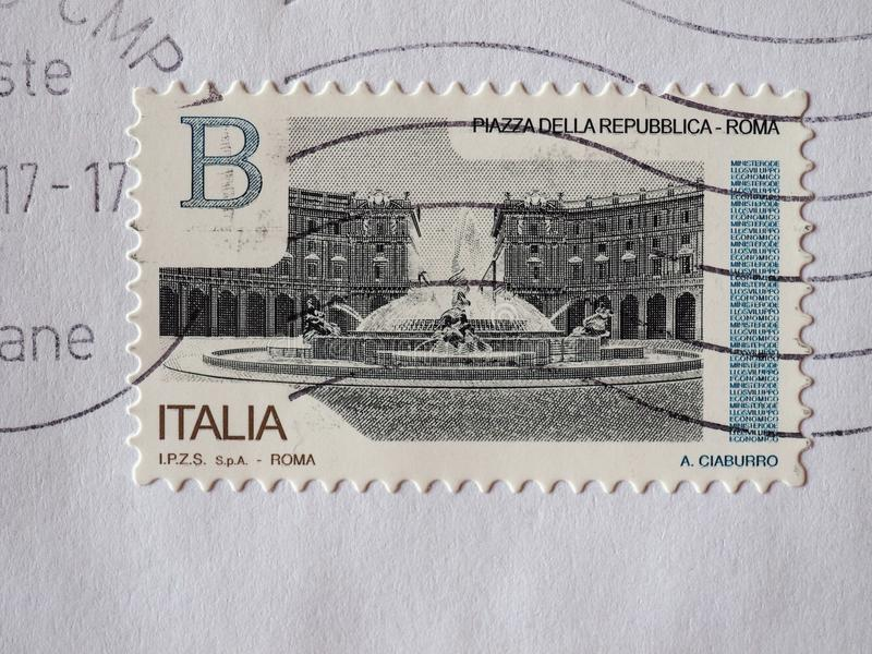 Stamp of Italy in Turin. TURIN, ITALY - CIRCA DECEMBER 2017: a class B stamp printed by Italy showing Piazza della Repubblica square in Rome stock photos