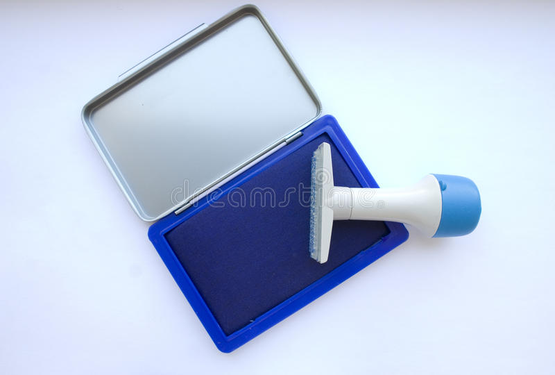 Stamp and pad. Office stamp with blue ink pad stock photos
