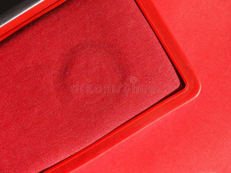 Stamp pad with red ink. A stamp pad filled with red ink stock photo