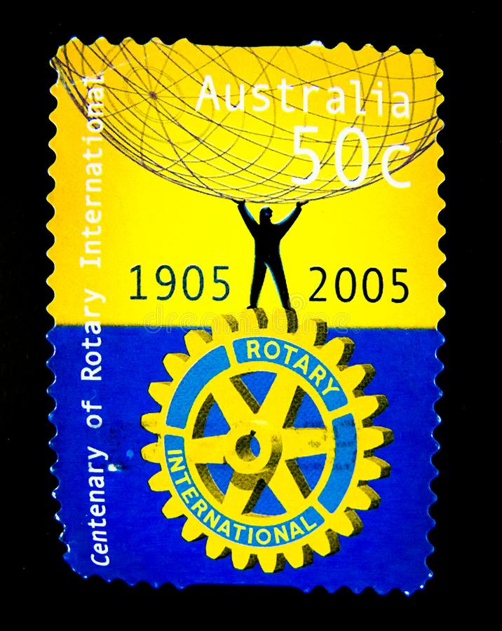 A stamp printed in Australia shows an image of Rotary international 1905-2005 on value at 50 cent. royalty free stock photo