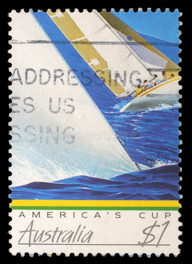 Stamp printed in Australia shows image of a yacht competing the America`s Cup stock photography