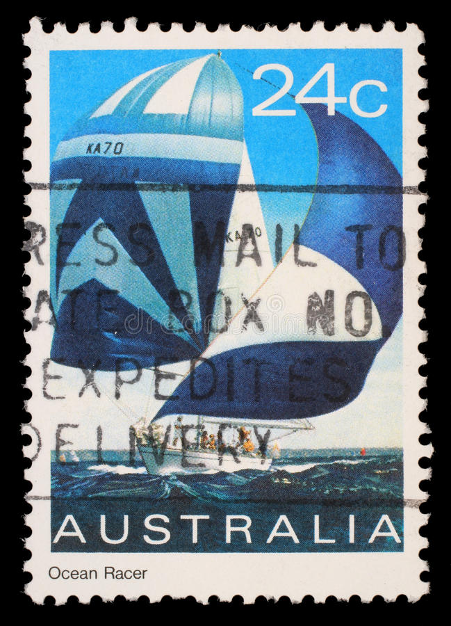 Stamp printed in Australia shows an ocean racer royalty free stock photo