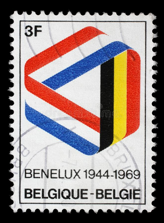 Stamp printed in the Belgium shows Mobius Strip in Benelux Colors, 25th Anniversary of the Signing of the Customs Union, circa. 1969 stock image