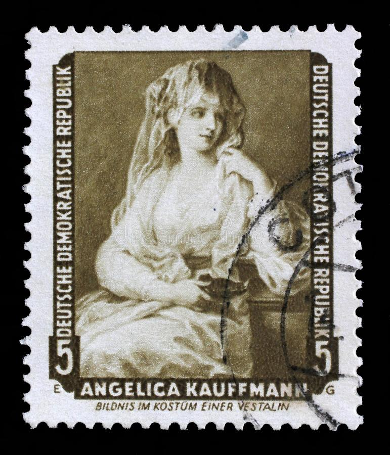 Stamp printed in DDR shows the painting Portrait of a Lady as a Vestal Virgin, by Angelica Kauffmann. A stamp printed in DDR shows the painting Portrait of a stock photography