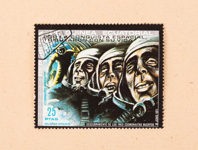 A stamp printed in Equatorial Guinea shows three cosmonauts, circa 1967. EQUATORIAL GUINEA - CIRCA 1967: A stamp printed in Equatorial Guinea shows three royalty free stock photo