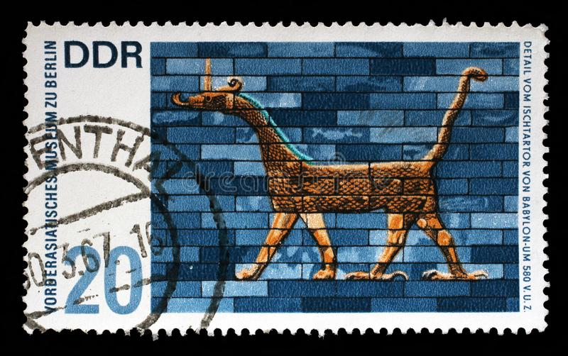 Stamp printed in Germany shows Museum of the Ancient Near East in Berlin, detail from the Ishtar Gate of Babylon stock photo