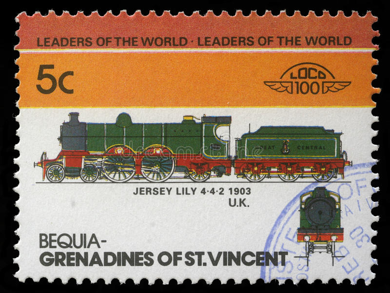 A stamp printed in Grenadines of St. Vincent shows Jersey Lily Train 4-4-2 royalty free stock images