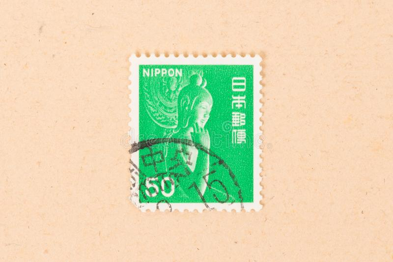 Stamp printed in Japan shows a statue, circa 1980 stock photo