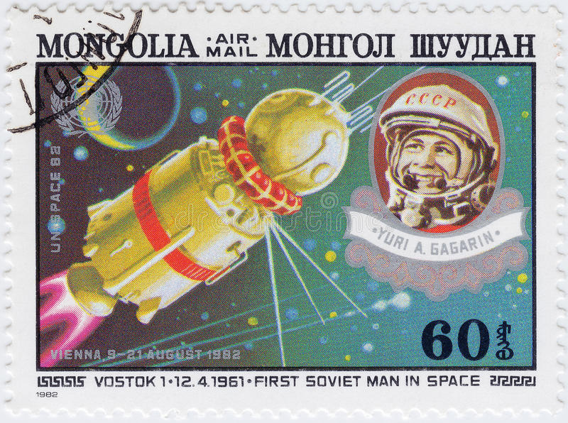 Stamp printed in Mongolia with Gagarin stock images
