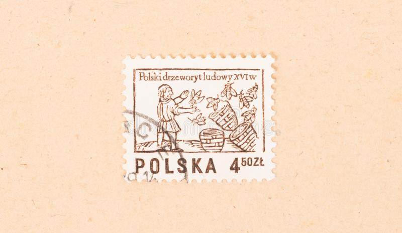 A stamp printed in Poland shows a beekeeper with his hives, circa 1970 stock photos