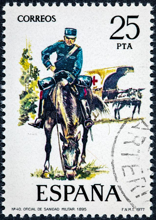 Stamp printed in Spain shows Military Health Officer 1895. SPAIN - CIRCA 1977: A stamp printed in Spain shows Military Health Officer 1895 royalty free stock image