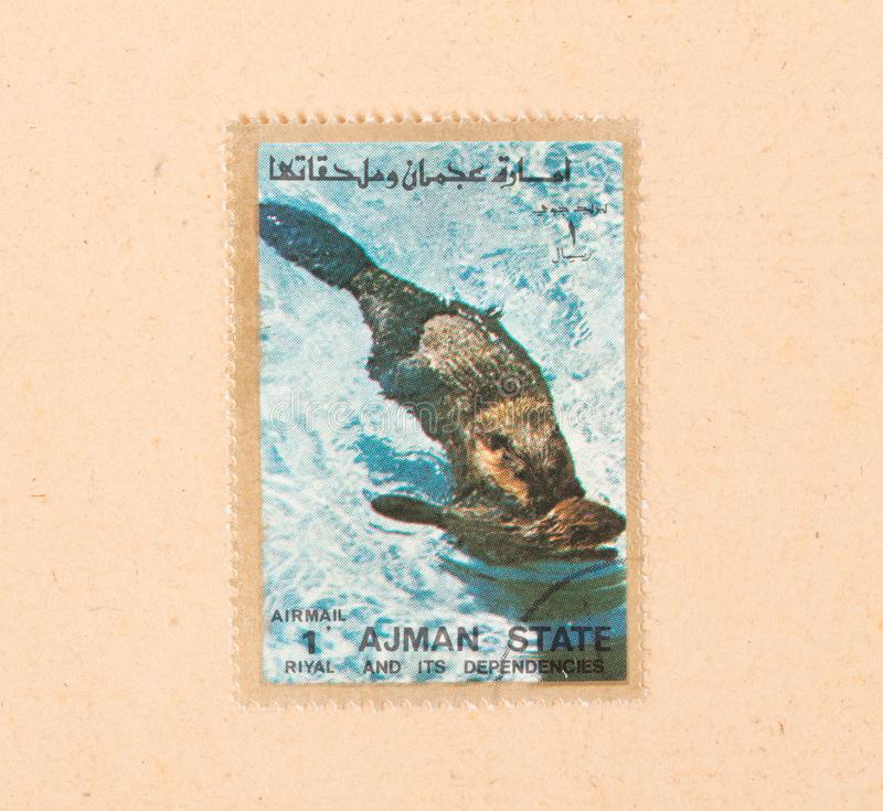 A stamp printed in the UAE shows a beaver, circa 1980 royalty free stock photography