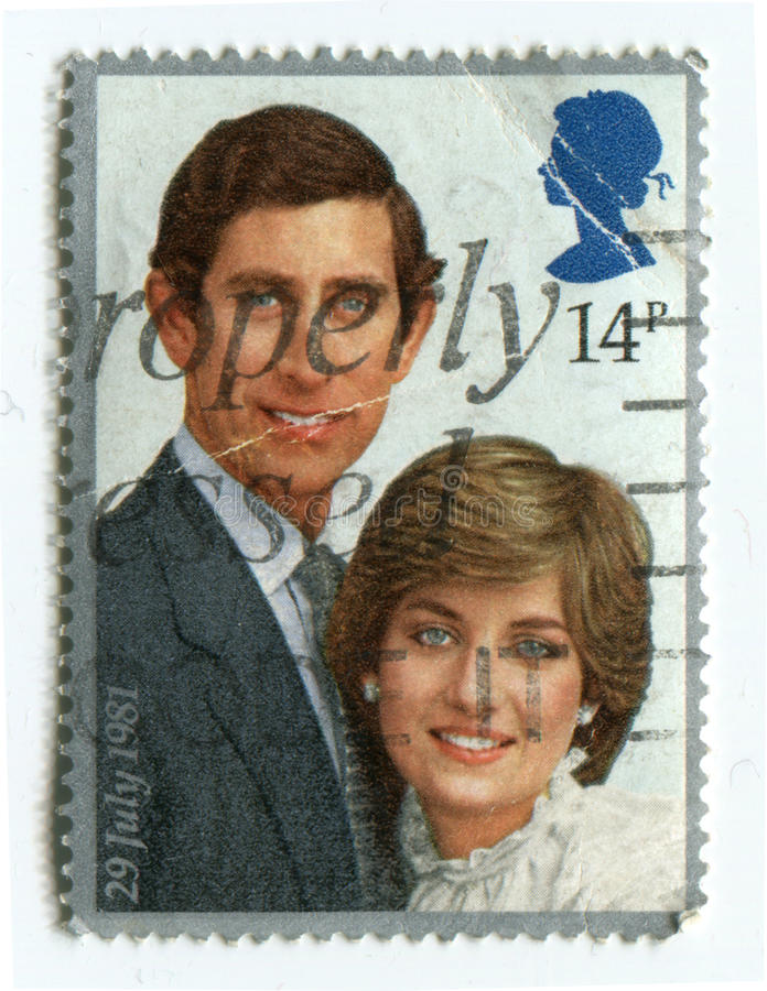 A stamp printed in UKshows portraits of Prince Charles and Diana, circa 1981 royalty free stock image
