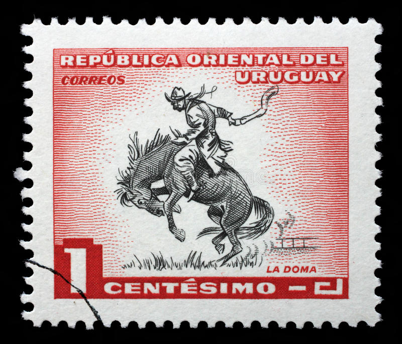 Stamp printed in Uruguay shows taming a horse. A stamp printed in Uruguay shows taming a horse, circa 1954 royalty free stock photography