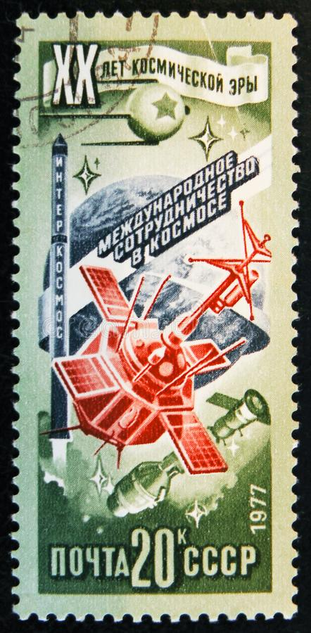 Stamp printed in USSR shows space ship, circa 1977. MOSCOW, RUSSIA - APRIL 2, 2017: A post stamp printed in USSR shows space ship and devoted to 20 Space stock photo