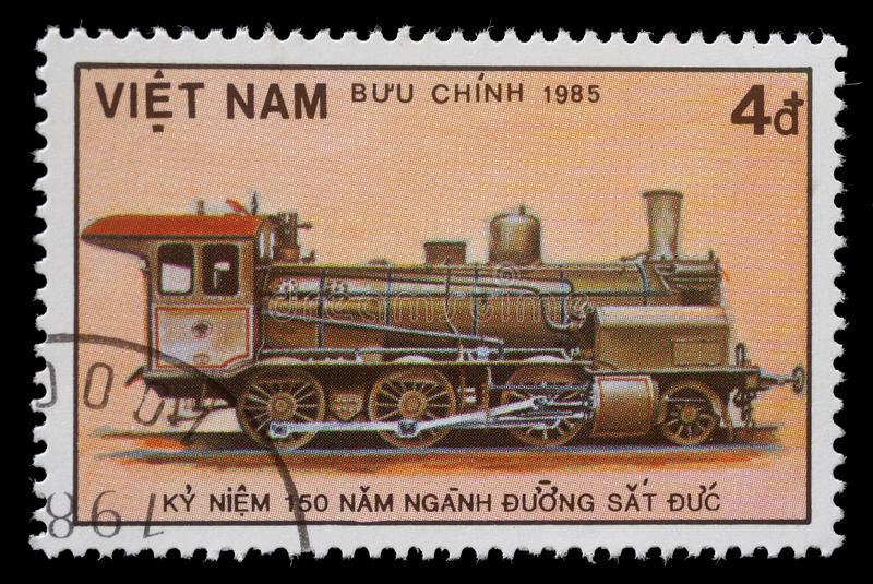 Stamp printed in Vietnam showing steam locomotive royalty free stock photo
