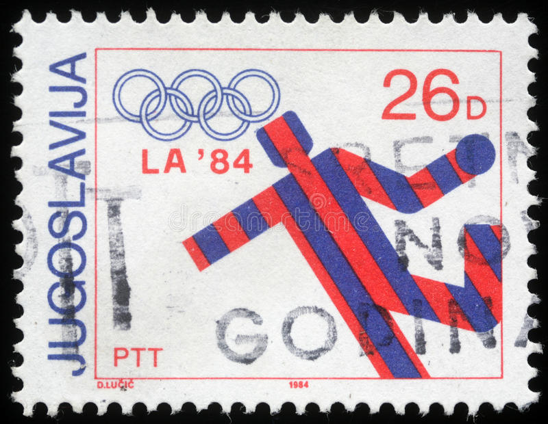 Stamp printed in Yugoslavia shows Olympic games in Los Angeles. Circa 1984 stock photography
