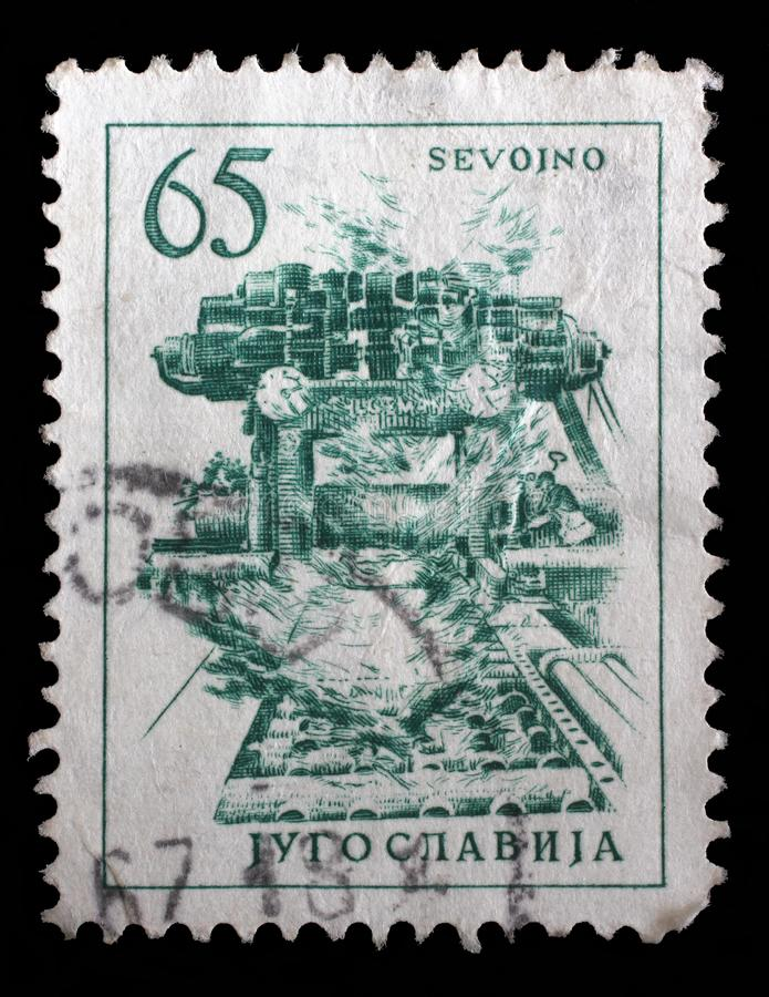 Stamp printed in Yugoslavia shows steel plant in Sevojno a local community in western Serbia stock photography