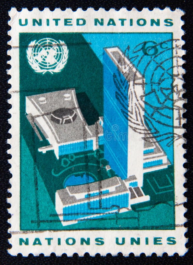 A stamp shows building of United Nations stock photo