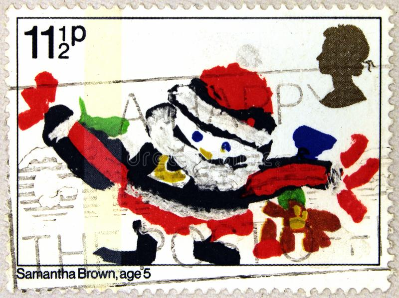 A stamp of UK shows Santa Claus, Drawing by Samantha Brown royalty free stock photography