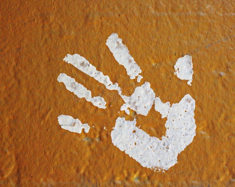 Stampa della mano verniciata sulla parete fotografia stock