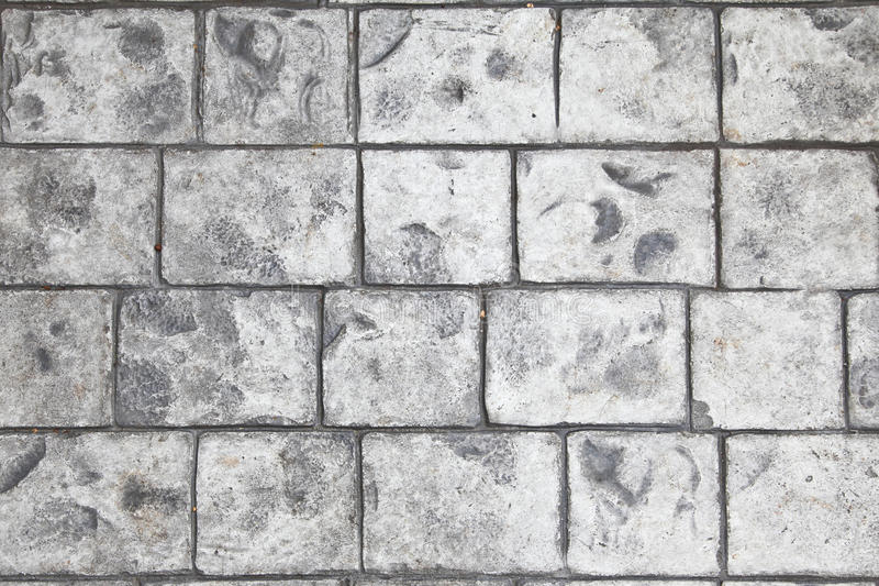 Stamped concrete floor background. In grey color stock image