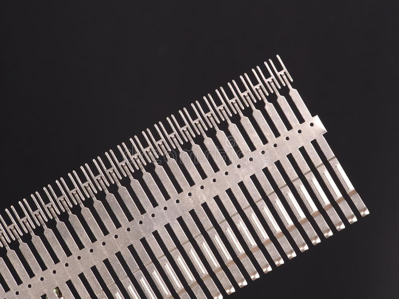 Stamped and plated row of precision springs. On black background, Australia 2015 stock photos