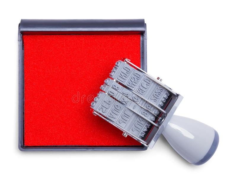 Stamper With Pad. Grey Rubber Date Stamper and Ink Pad Isolated on White Background royalty free stock photography