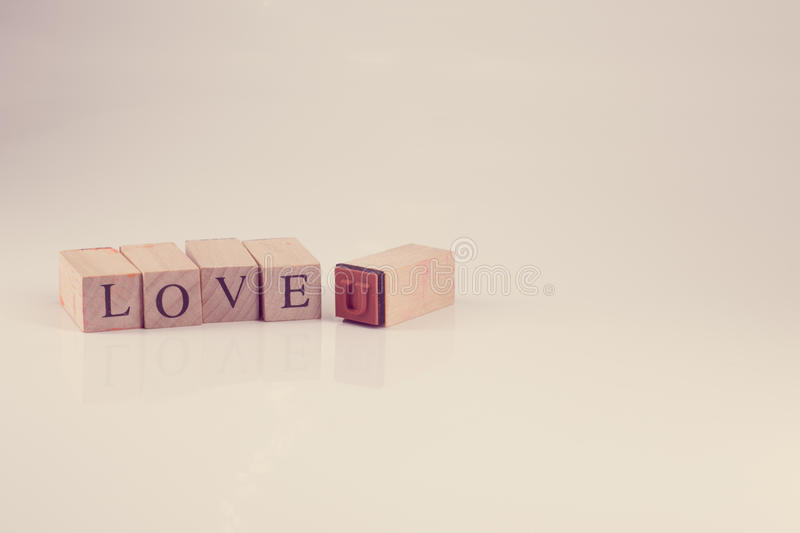 Stamping blocks alphabet LOVE YOU spelled, vintage style stock photos