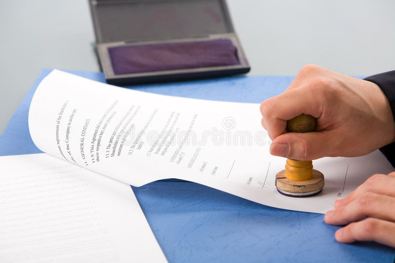 Stamping the document stock photos