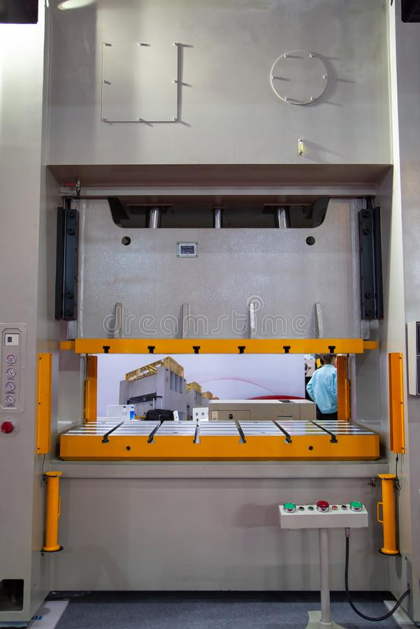 Stamping press machine. Large metal stamping press machine, industrial manufacturing stock photography