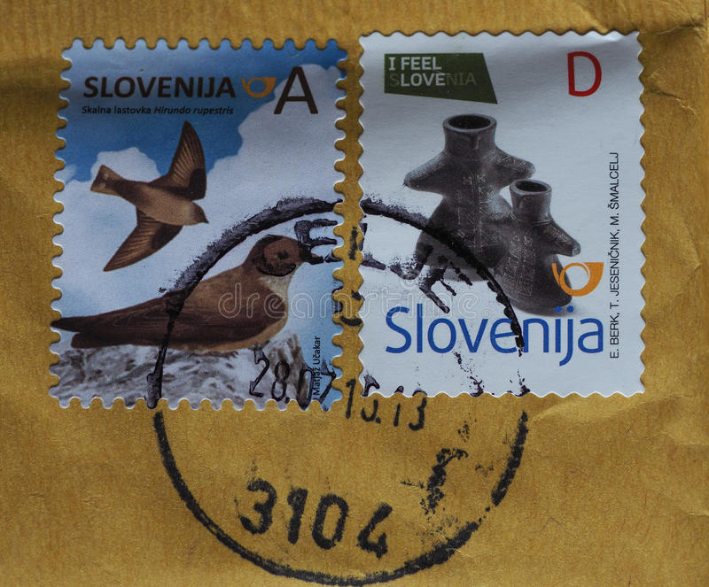 Stamps of Slovenia. LJUBLJANA, SLOVENIA - CIRCA AUGUST 2016: stamps printed by Slovenia showing birds and figural vase (series: I feel Slovenia stock images